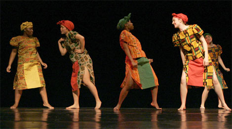 photo of dancers dressed in African fabrics